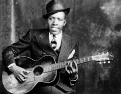 Robert Leroy Johnson (May 8, 1911 – August 16, 1938) was an American blues singer and musician. His landmark recordings from 1936–1937 display a combination of singing, guitar skills, and songwriting talent that have influenced later generations of musicians. Johnson's shadowy, poorly documented life and death at age 27 have given rise to much legend, including a Faustian myth. As an itinerant performer who played mostly on street corners, in juke joints, and at Saturday night dances…