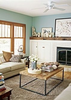 Aqua walls living room by mildred
