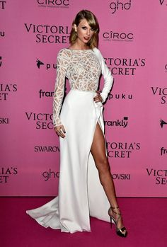 Dying, DYING over Taylor Swift's 2014 Victoria's Fashion Show entrance gown. This beautiful, crisp white gown mixes media beautifully with a lattice, sheer top, flowing fabric, and thigh-high slit. And her makeup, hair, and THOSE shoes are amazing.