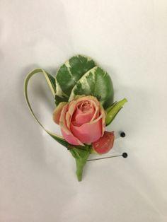 Miniature pink rosebud makes a fine garden wedding style boutonniere for a junior groomsmen. Boutonniere by Seasonal Celebrations. http://www.seasonalcelebrations.com/