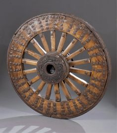 Lot 79A: Wagon wheel with hand forged iron details. Estimate: $200-$400.