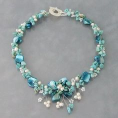 Add a floral element to your style with this mother of pearl, turquoise and freshwater white pearl necklace. This jewelry was handmade in the Philippines by artisan, Neri.