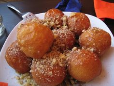 In Greece, loukoumades are commonly spiced with cinnamon in a honey syrup and can be sprinkled lightly with powdered sugar. In ancient Greece, these deep fried dough balls were served to the winners of the Greek Olympics. Greek Sweets, Greek Desserts, Greek Recipes, Fun Desserts, Beignets, French Donuts, Greek Cookies, My Best Recipe, Mediterranean Recipes