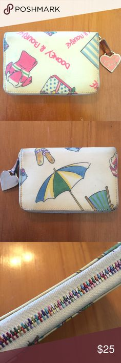 {Dooney & Bourke} Summer Print Wallet This wallet is a must-have for your summer wardrobe. With a beach-themed print on a cream background and unique candy colored zipper, it will add a touch of fun to any handbag you pair it with!  While the outside is slightly discolored and could use some cleaning, the inside is in very good condition, no tears or marks. This wallet is approximately 5.5 by 3.5 inches (15 x 10cm). Dooney & Bourke Bags Wallets