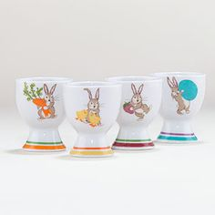 Bunny Egg Cups, Set of 4  $7.96  Infuse a healthy dose of playfulness into your Easter celebration with our set of four porcelain Bunny Egg Cups. An easy way to make a festive impact at an affordable price, each cup features a cute-as-a-button bunny with an egg, strawberry, carrots or chicks.    Bunny Egg Cups sold in a set of 4   Made of porcelain with a bunny decal   Dishwasher safe   World Market exclusive
