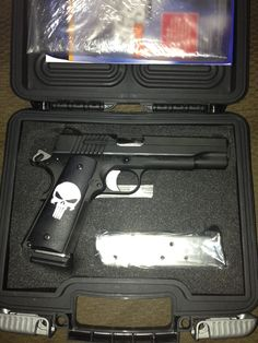 Sig Sauer 1911 45cal w/punisher grips