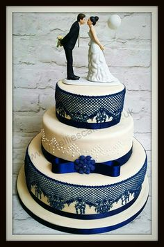 Congratulations to Sara and Pete on their wedding. I was delighted to be asked to make their wedding cake. Three tiers incorporating vanilla, chocolate and lemon cakes with edible navy cake lace and piped drop pearls.