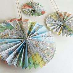 Rosette: Create rosettes out of maps (instructions here) for decor in your Adult department. Source: GrannyPantyDesignsRosette: Create rosettes out of maps (instructions here) for decor in your Adult department. Map Crafts, Arts And Crafts, Crafts With Maps, Retro Crafts, Travel Crafts, Going Away Parties, Festa Party, Elmo Party, Mickey Party