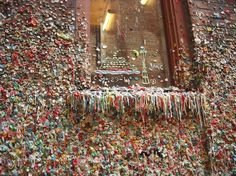 The Market Theater Gum Wall is in an alleyway in downtown Seattle. People waiting in line at the box office for the theater started sticking gum here in the 1990s, and theater workers eventually despaired of scraping it all off.