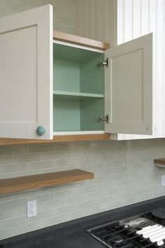 paint the inside of the cabinets to match the knobs!