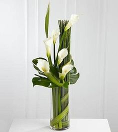 The FTD® Eternal Friendship™ Arrangement is an outstanding way to express your deepest sympathies for their loss. Sophisticated white calla lilies are skillfully arranged amongst a collection of exqui Contemporary Flower Arrangements, White Flower Arrangements, Vase Arrangements, Centerpieces, Centerpiece Wedding, Wedding Arrangements, Wedding Decor, Arte Floral, Deco Floral