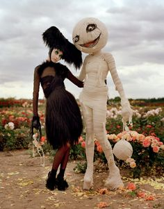 the Tim Burton-y skeleton is inspiration for my halloween lawn decorations this year...