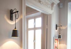 Hooked Wall sconce by Buster + Punch