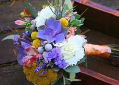 Bridal bouquet, purple succulents, white carnations, lavender, billy balls/ craspedia, brunia berries, mokora orchids