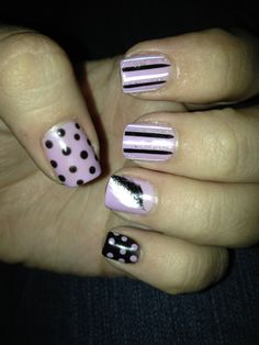 Nail art! Feather and polka dots I love