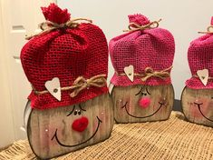 Adorable rustic snowman holiday wooden decor. This primitive, yet modern looking snowman has been cut, sanded, painted, sanded again, then stained. I then embellished it with pink or red burlap, a few jute bows, a mini white heart and a fuzzy heart nose. It's so cute! Please zoom in on