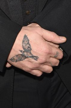Whose famous hand boasts this beautiful Crow Tattoo?
