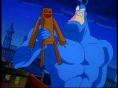 The Tick Cartoon | The Tick shows off his new pal, the lovely wooden boy he made