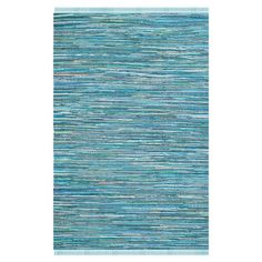 Anchor your living room seating group or define space in the den with this artfully hand-woven cotton rug, awash in a blue hue for a pop of color.