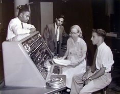 A 1957 photograph of programmers at work, including Rear Admiral Grace Hopper