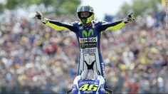 Valentino Rossi celebrates after winning the Dutch Grand Prix at Assen, his third victory of the 2015  season.