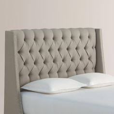 Refresh the look of your bed with our custom-made headboard, handcrafted in the U.S.A. with nail trim and textured woven upholstery in an array of hues. Its tufted wingback silhouette enhances a wide range of bedroom decor.