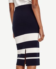 """Smartly placed stripes in strong, confident hues delineate this long and lean knit. 8"""" back slit. 30"""" long."""