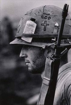 Profile of Marine with rifle, with helmet bearing a can opener.
