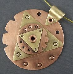 Copper and Brass Mixed Metal Mod Circles and Triangles 2 Pendant. $89.00, via Etsy.