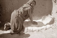 Old Picture of the Day: Grinding Grain (African Woman, recent photo posted on 28/12/12, click link for more info)  Writing Prompt: who is this woman and what is she doing? What is she thinking? Does she have a family? Where does she live?