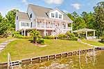 Fabulous Lake Martin home w/boathouse w/ 2 boats lifts, PWC lifts, boat ramp, deep water, BIG views, porches, outdoor kitchen & more.  6 BRs, 4 full BAs & 2 1/2 BAs. Family space & kitchens on both main & terrace levels. Amanda Scroggins, 256.749.6634, RE/MAX Around The Lake. Photos & tour by Sherry Watkins…I Shoot Houses…http://www.Go2REassistant.com/VirtualTours.htm