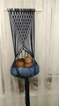 Your cat is going to adore to swing and sleep in this macrame cat hammock! It is also perfect for a modern-boho statement piece in any room. Easy to hang up on the wall, ceiling and firm shelf. There's an attached rope to hang the hammack. Just make sure your pet can reach it from the floor or stand by furniture.  It's made of eco-friendly materials: high quality cotton cord, wooden stick. The pillow is also handmade, it's very fluffy and comfy. There's color and size choice. Worldwide shipping. Macrame Plant Hanger Patterns, Macrame Wall Hanging Diy, Macrame Art, Macrame Design, Macrame Projects, Macrame Knots, Macrame Patterns, Diy Cat Hammock, Cat Furniture