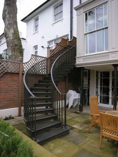 The Norfolk Road Project - This gracefully curved staircase was designed to take up minimal space in this courtyard garden.