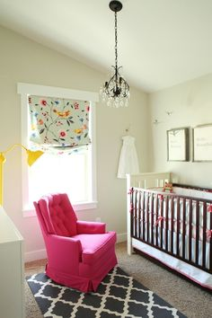 This is a nursery, but it might be the prettiest room i've ever seen - curtains match the subtle room color, chair and lamp give it an extra something special.
