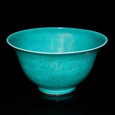 Ming, A Rare Peacock-Blue-Glazed Bowl Incised in the  Exterior with Flying Cranes amidst Wispy Clouds above a Classic Scroll Band. The interior well with a cloud scroll. Ming Dynasty, Zhengde Mark and of the Period