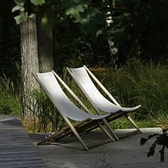Skargaarden's H55 recliner in teak, fabric and stainless steel, designed by Björn Hultén. H55, designed in Helsingborg for an exhibition of the same name in 1955, is unbelievably comfortable, with four different recline settings. Comes standard with matching head pillow, in three standard colors.