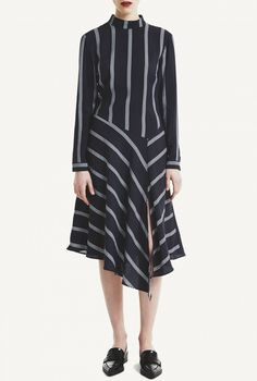 Everlyis a midi long sleeveddress with geometric lines. It has a high neckline and a slit in the front left side.The geometric lines gives the dress a flattering silhouette, yet contemporary and progressive look.