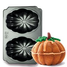 "Create perfectly sweet pumpkin cakes! 15"" L x 7 3/4"" W x 4 1/2"" H. Dishwasher safe. Oven safe up to 450° F. Cast aluminum. Imported."