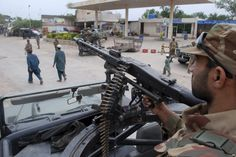 Pakistani army soldiers take positions a day before the nationwide election, in Peshawar. An especially violent spate of killings, kidnappings and bombings has marred the run-up to Pakistan's nationwide election to be held on Saturday.