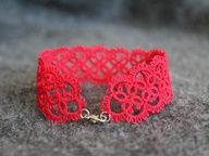 Red handmade bracelet. Delicate lace design, high quality cotton thread. (Kristina note: This is tatted lace done with a shuttle . . . my mom used to make lovely things like this!)