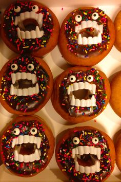 Doughnut monsters for Halloween fun food with chocolate icing and rainbow sprinkles. Sort of homemade with Wilton eye ball candy bought from the grocery store and some help from Dunkin Donuts. Halloween Donuts, Halloween Eyes, Halloween Treats, Halloween Foods, Halloween Party, Holiday Snacks, Party Snacks, Donut World, Donuts