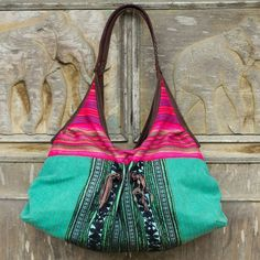 NOVICA Fair Trade Cotton Shoulder Bag with Leather Trim ($108) ❤ liked on Polyvore featuring bags, handbags, shoulder bags, accessories, clothing & accessories, pink, tribal print purse, man shoulder bag, bohemian shoulder bag and pink purse