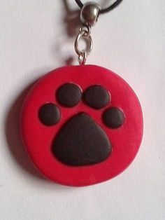 Red and black polymer clay paw print necklace for by KaisCards, £5.00