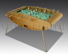 Opus Luxury Football Table. The Opus is the pinnacle of Football Table design. Its curved, smooth frame is hand crafted in etched glass and stainless steel, and the players are made of cast metal. #TableFootball #WorldCup2014