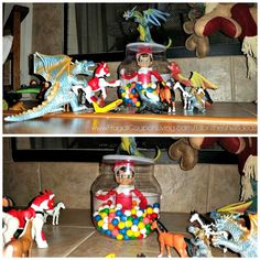 Funny Elf on the Shelf Ideas –  Elf is Held Captive by dinosaurs in a bit of fire gum balls. This idea, daily elf ideas and FREE elf notes on Frugal Coupon Living.