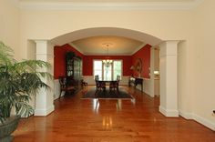 Formal dining room with an arched entry. Decor, Luxury, Newbury, Luxury Living, Home Decor, Formal Dining Room, Room, Fireplace, Dining Room