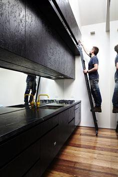 black OSB kitchen fronts