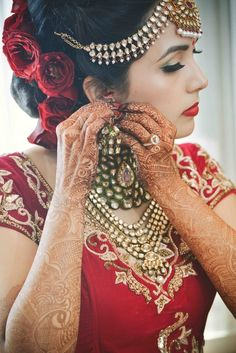 red roses, roses in hair, flowers in hair, floral hairstyle, floral bun, bride…