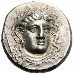 Silver stater, circa 369-358 BCE of Alexander of Pherai, Thessaly.  Head of Ennodia, an ancient Greek goddess associated with Artemis, Hecate, or Persephone on obverse. Reverse shows Alexander of Pherai riding.