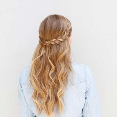 Pair easy, pretty waves with twin braids to create this elegant style—all you'll need are a few bobby pins. Try it for an afternoon of shopping or a casual date night. Get Step-by-Step Instructions